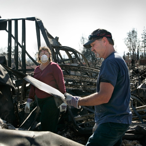 Family returns to their burned home