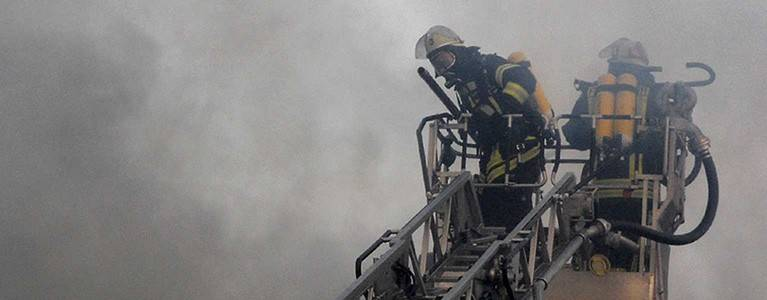 Fire fighters on ladder