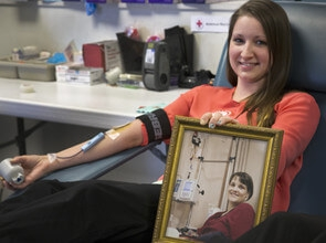 girl donates blood
