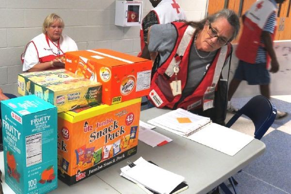 Hurricane Florence volunteers checking supplies in shelters